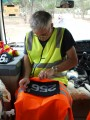 Trevor applies the team numbers to the night time riding vests